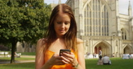 4k, Close up portrait of beautiful young woman using cellphone outdoors Stock Footage