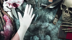 4k Horror and Bloody Composition of Hands putting on Latex Glove  Stock Footage