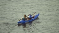Aerial view of couple rowing a kayak, slow motion Stock Footage