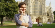 4k, handsome young man talking on his mobile phone while commuting to work. Stock Footage