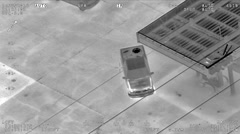 Aerial IR Footage of Bait Pickup Truck Stolen and Driving Away Stock Footage