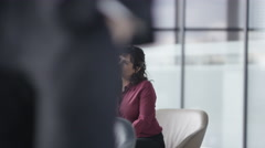 4K Corporate business group in discussion in busy meeting area of modern office Stock Footage