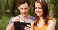 4k, Attractive couple taking a selfie on their digital touchscreen tablet. Stock Footage
