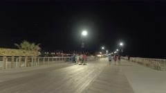 Walking on the boardwalk Stock Footage