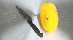 Kitchen knife cut through a papaya along its longitudinal axis. Stock Footage