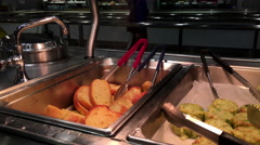 Motion of hot garlic bread with smoke at food court area inside Ikea store Stock Footage