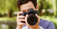 4k, Attractive male tourist taking a photo of you.  Stock Footage