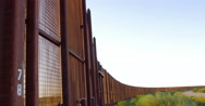 Tilt to Reveal the Border Fence Between Mexico and America - 4K Stock Footage