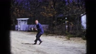 1956: a man wearing a tuxedo throws a football while outside. NEW YORK CITY Stock Footage