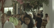 Tourists walking on a small street in the evening Stock Footage