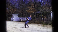 1956: man wearing suit and baseball mitt playing catch on an old road NEW YORK Stock Footage