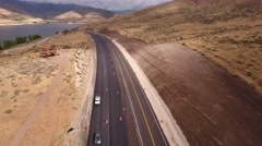 Aerial descending shot cars drive through a construction zone Stock Footage