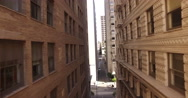 Drone flying  through a narrow alley with tall buildings Stock Footage