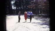 1956: three well dressed people walking down the street smoking cigarettes  Stock Footage