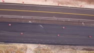 Aerial dolly shot as cars drive through the construction zone Stock Footage