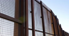 A Large Rusted Metal Wall Separating Two Countries Stock Footage