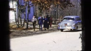 1956: family walking past car while leaving church NEW YORK CITY Stock Footage
