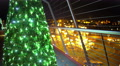 Nice illuminated Christmas tree on top of skyscraper, festive night city lights 4k or 4k+ Resolution