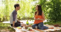 4k, Young woman proposes marriage to her boyfriend whilst on a picnic. Stock Footage