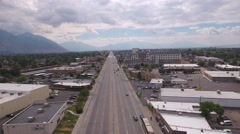 Aerial high shot of a busy city and large street with cars Stock Footage