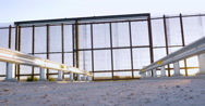 Low Angle Reveals a Gate in a Large Metal Fence on the Borderline Stock Footage