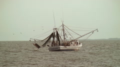 Shrimp boat in ocean Stock Footage