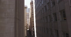Drone fly up in a narrow alley with high rise buildings Stock Footage