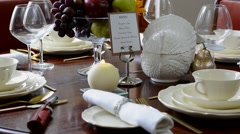 Elegant formal Thanksgiving table in front of garden window Stock Footage