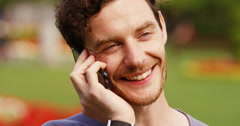 4k, Handsome young casual man using a mobile phone. Stock Footage