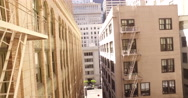 Drone flying backwards in a narrow alley with tall buildings Stock Footage