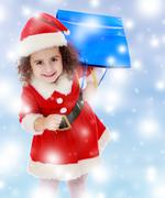 Little girl in costume of Santa Claus with colorful packages Stock Photos