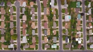 Aerial high shot of a cities suburbs Stock Footage