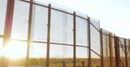 Sunlight Shines Through the Bars of the Fence Dividing Mexico and America Stock Footage