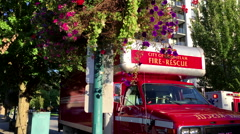 Close up Coquitlam city fire rescue car stopping on accident scene Stock Footage