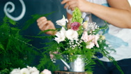 Florist at work: woman making fashion modern bouquet of different flowers Stock Footage