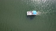 Aerial high shot of boat traveling across a lake Stock Footage