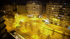 Traffic on central street at night city, deserted business center in megalopolis Stock Footage