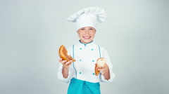 Portrait young baker breaks bread bagel gives you one piece at camera Stock Footage
