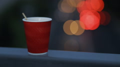 Good evening with a cup of tea at night lights background Stock Footage