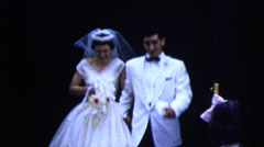 1962: newlyweds walking out of church followed by smiling wedding party NEW YORK Stock Footage