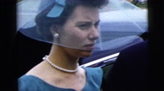 1962: well dressed woman in blue with white pearls taking in group NEW YORK CITY Stock Footage