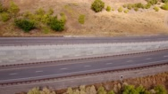 Aerial shot above cars traveling on a mountain highway with fall colors Stock Footage