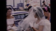 1962: a beautiful bride in a traditional white wedding dress  Stock Footage