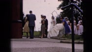 1962: bride arrives accompanied by her bridesmaids to the ceremony venue  Stock Footage