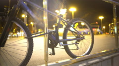 Bicycle parked on sidewalk in big city, active lifestyle, clean urban transport Stock Footage