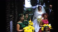 1962: the bride, groom, bridesmaids and groomsmen standing to take outdoor Stock Footage