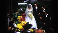 1962: a beautiful bride is getting ready to throw her bouquet out  Stock Footage
