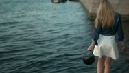 A pretty young girl walking along the promenade Stock Footage