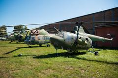 Old military helicopters stands in Prague Aviation Museum Kbely Stock Photos