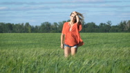 Full lenght portrait of a beautiful blonde young romantic woman in a red shirt Stock Footage